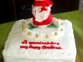 Music embossed on top of cake with handmade choirboy