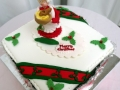 Christmas cake with Mrs Claus and decorations