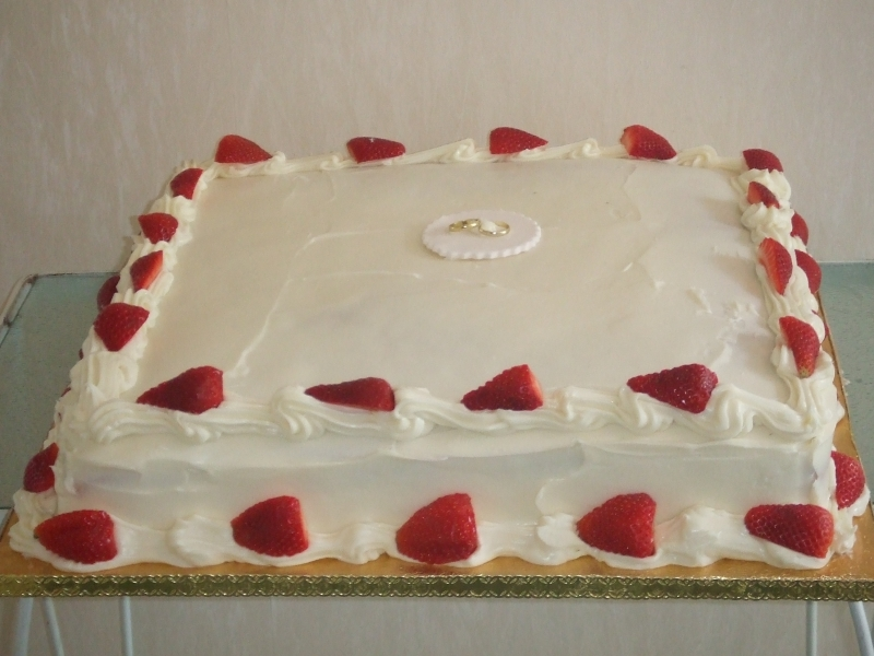 Edith's Wedding Sponge Cake with Strawberries and Cream Covered with White Truffle Icing
