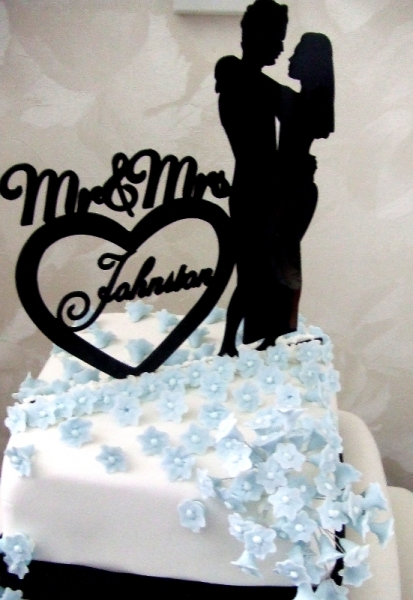 Hayley and Josh Johnston Cake Topper and Top Tier of Wedding Cake