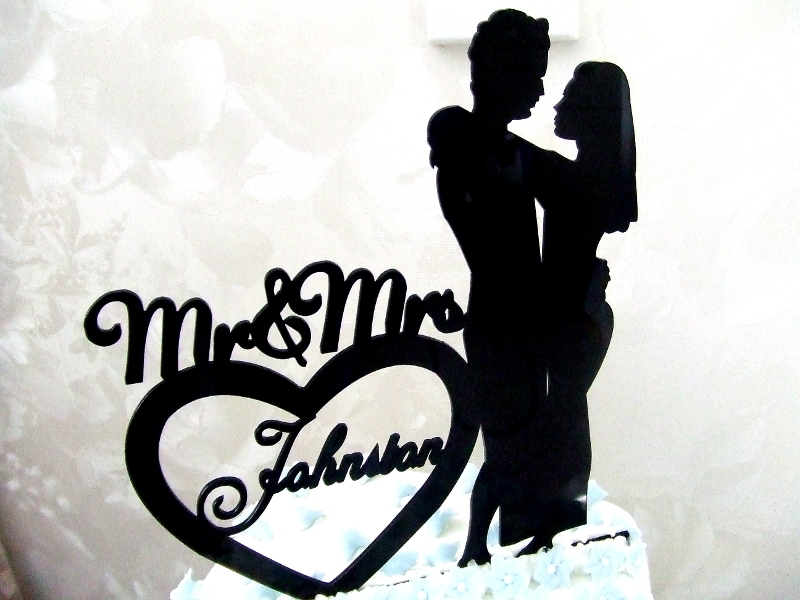 Close Up View of Cake Topper for Hayley & Josh Johnston's Wedding Cake