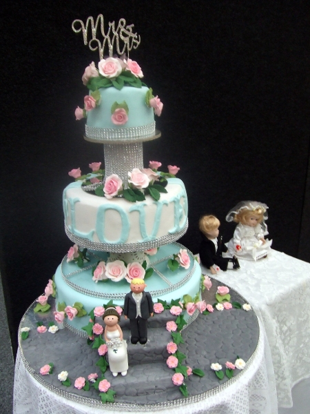 Margaret's original design -3 tier wedding cake in egg duck blue with diamantes & pink roses in two tone